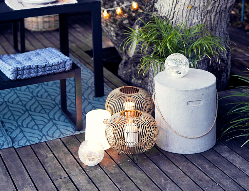 Garden lanterns and solar lamps on patio