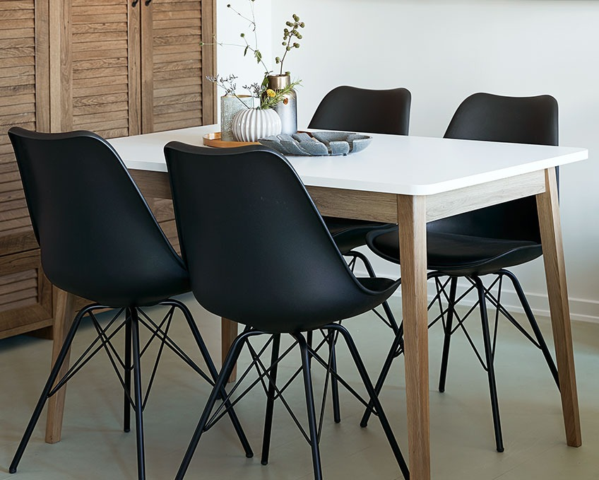 Black dining chairs at a dining table