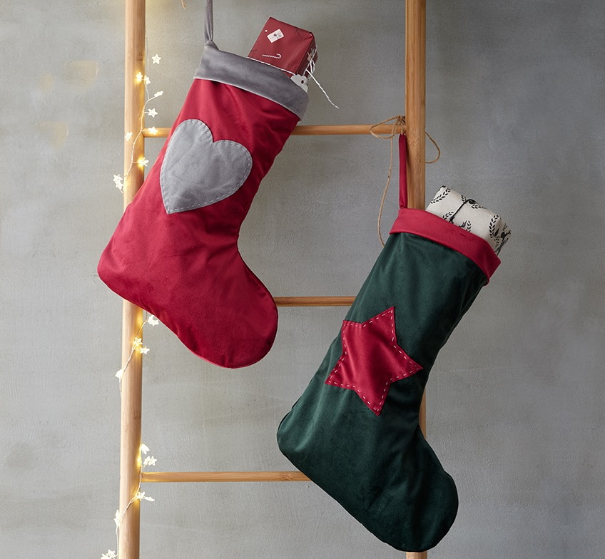 Christmas socks in red and green on a decorative ladder