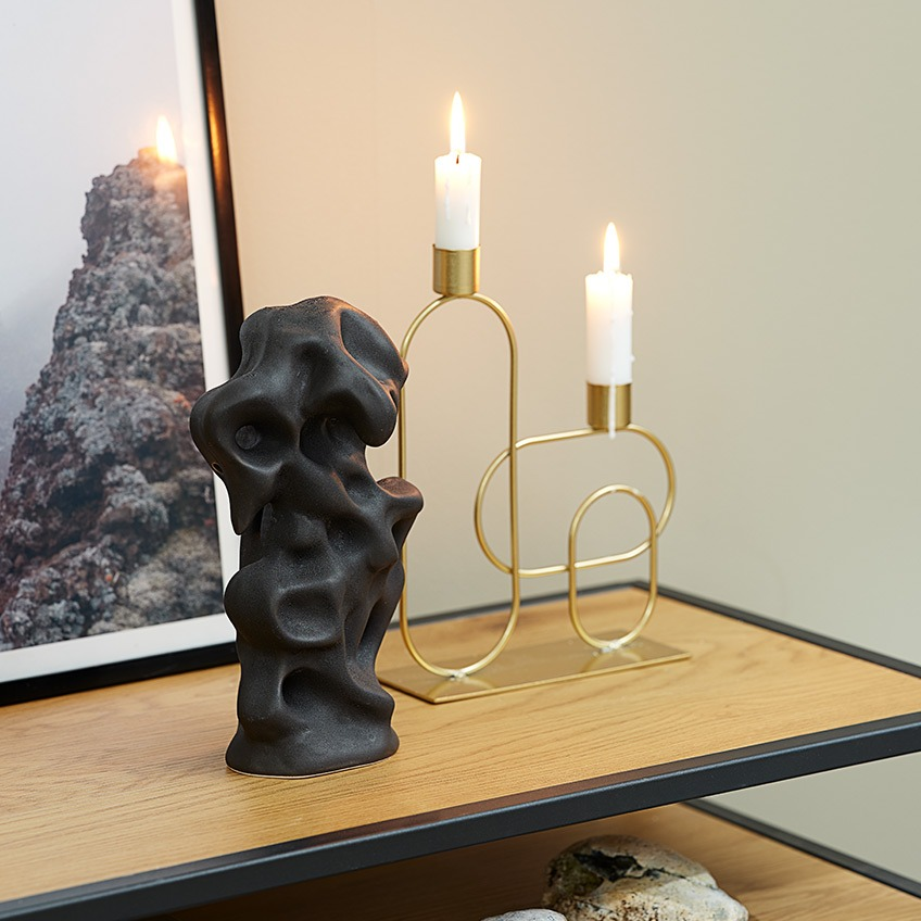 Candlestick in gold-look and black, crooked sculpture