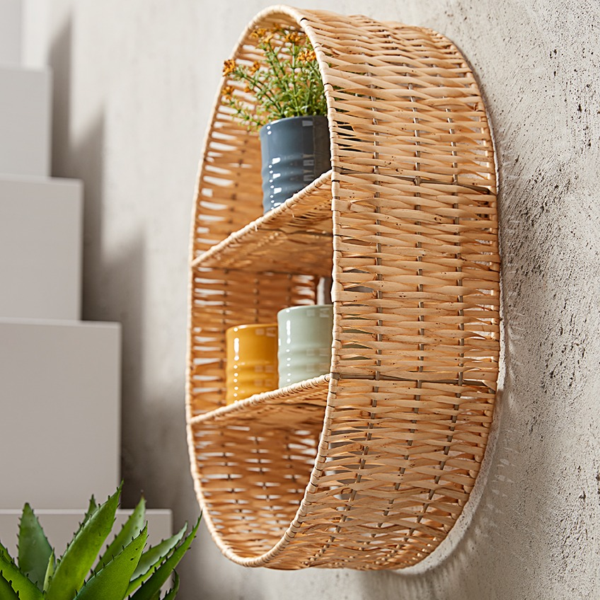 Wicker wall shelf with coloured plant pots