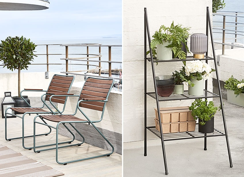Two lounge chairs on a balcony and a plant ladder with planters, boxes and vases