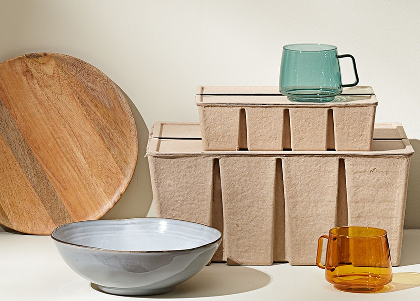 Wooden tray, stoneware bowl, storage boxes out of recycled paper and glass mugs